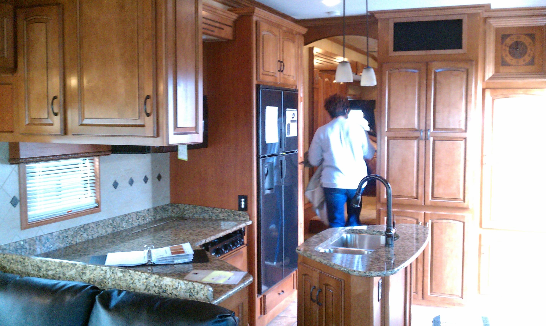 Kitchen leading to bedroom. Drv Elite Suites 2011