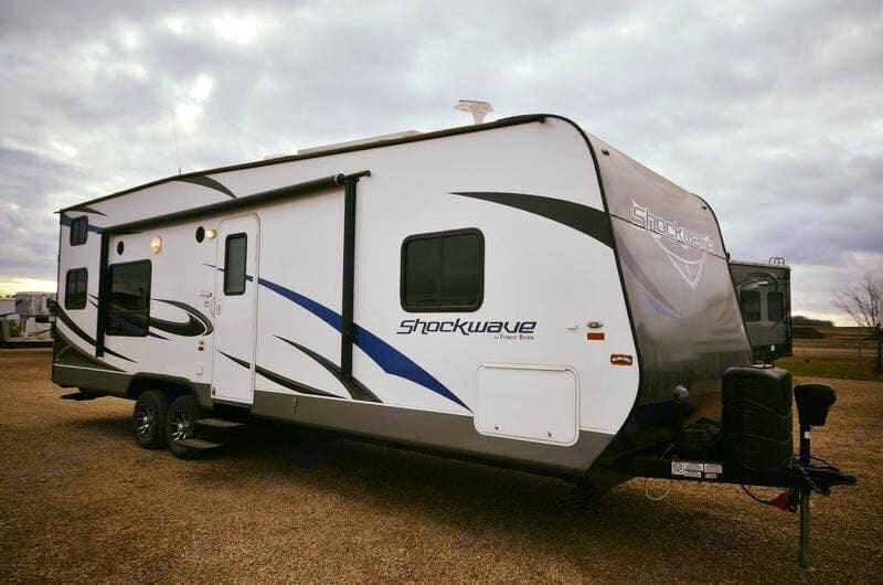 Camper has electrical operated 8x4 owning and one slide out Happy camping. Forest River Shockwave T27FQDX 2014