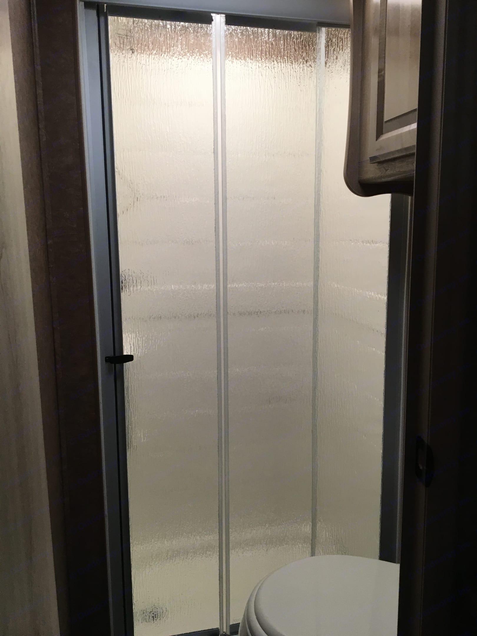 Bathroom with full shower . Coachmen Prism 2015