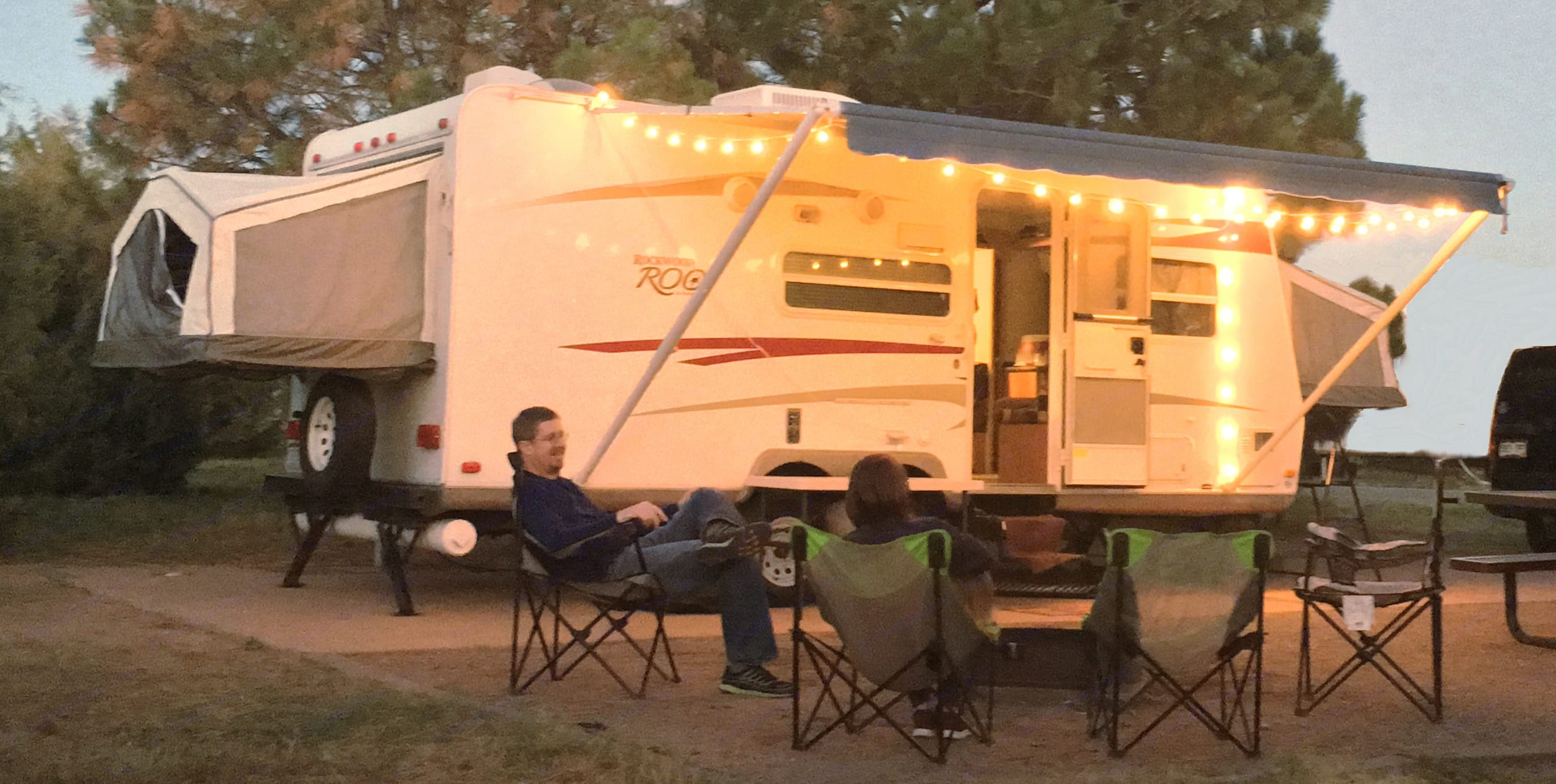 With the awning out and lights strung up, feels very homey!. Rockwood Roo 233S 2010