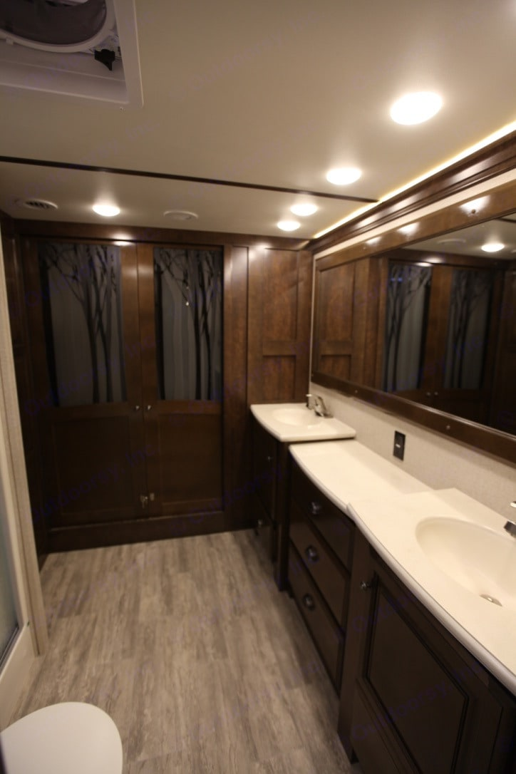 This amazing bathroom is nicer than most homes! Long countertop with dual sinks! YES PLEASE!. Redwood 3901WB 2017