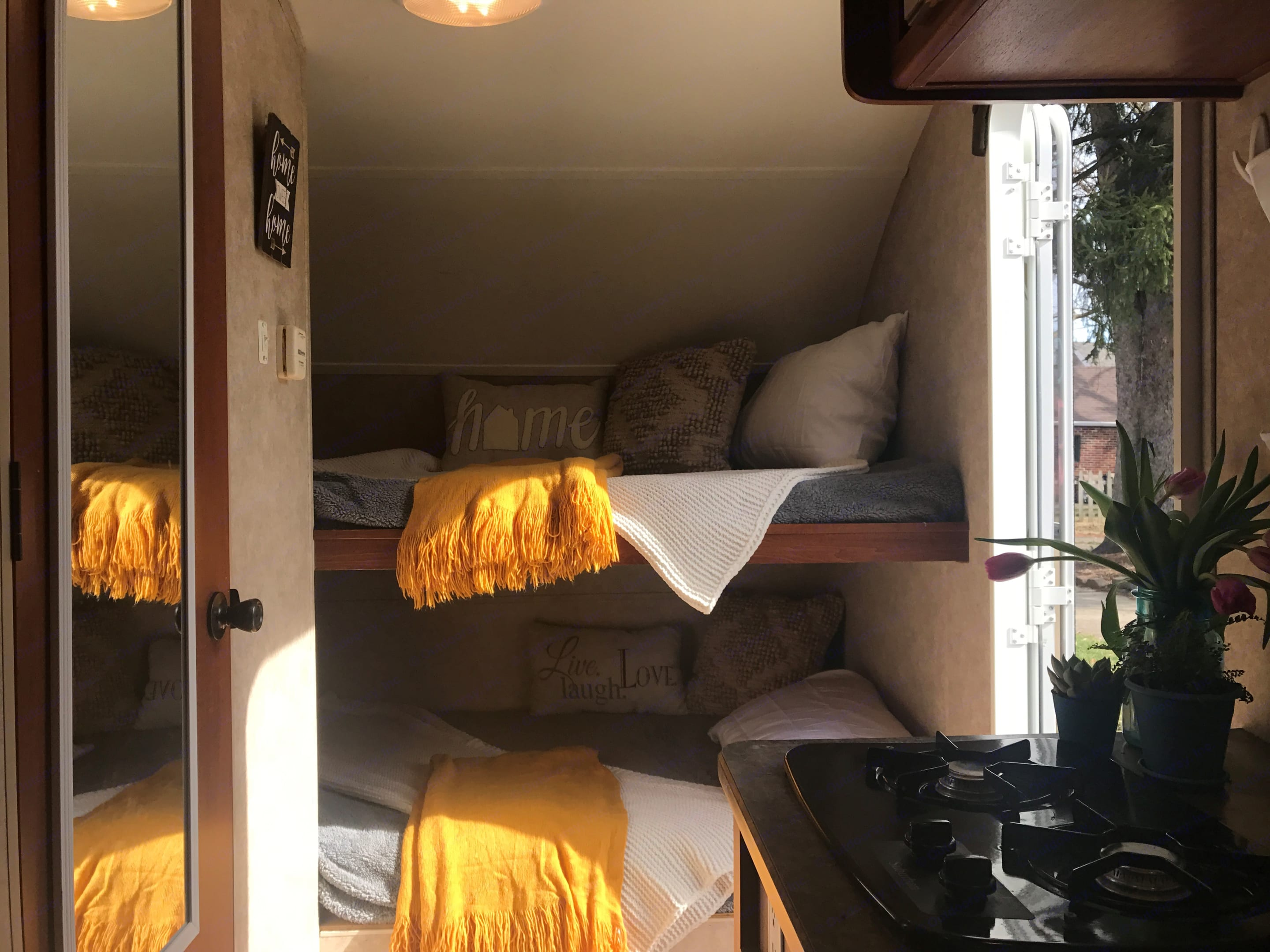 The bunks are very spacious and great for kids or adults. Top bunk holds up to 200 lbs. Each bunk has its own light for reading, etc.... Forest River R-Pod 2009