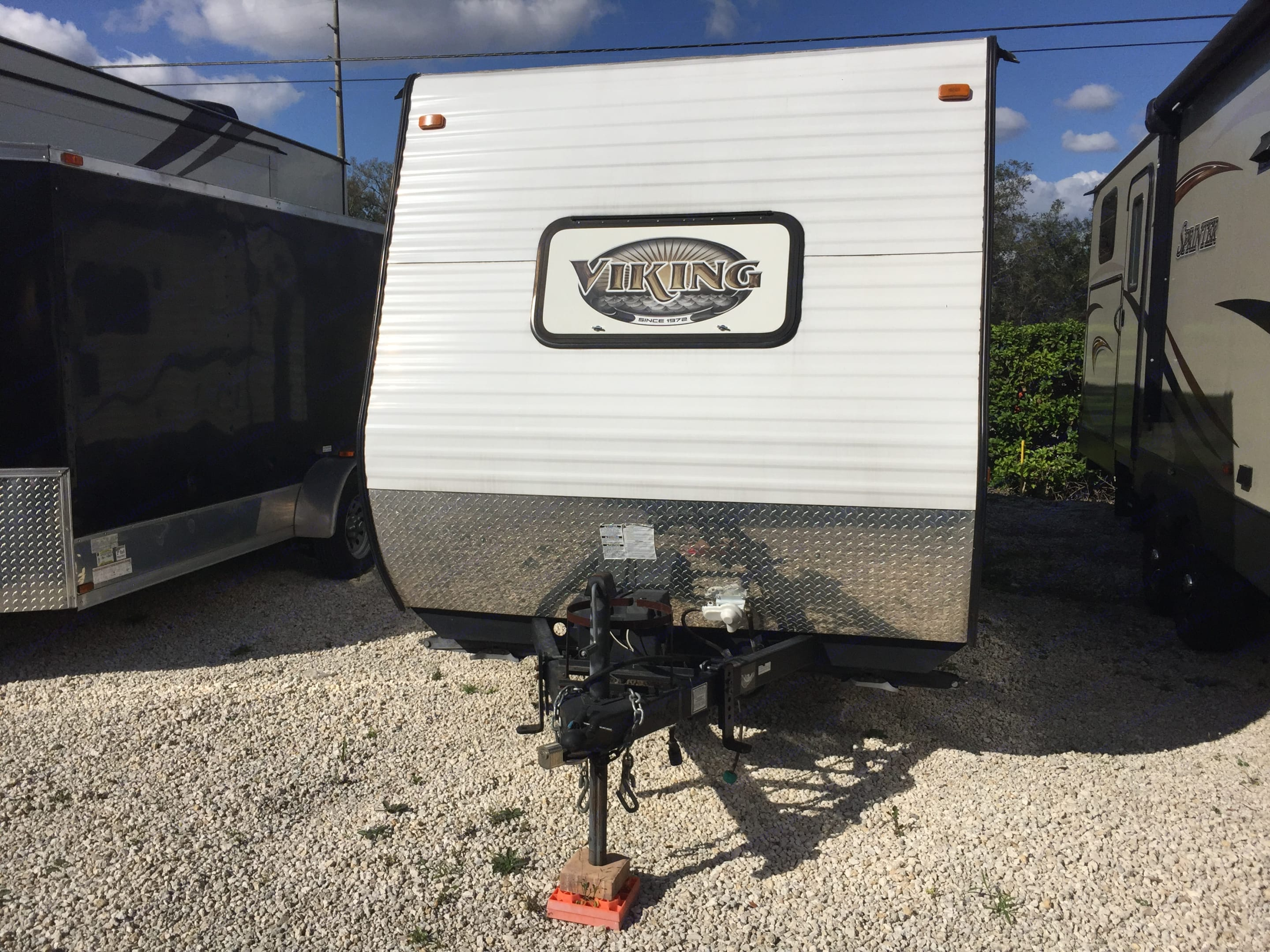 Heavy duty tongue and hitch mount for safer traveling on highways! This is also where the propane tank is stored which is included as part of the rental! You will need the propane tank for the hot water heater along with the stove top area and the furnace in Winter! This area is also where the back up battery is stored.. Coachmen Viking 2015