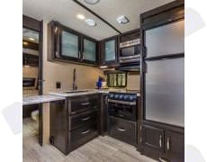 The kitchen features updated stainless steel appliances, a deep sink (for a RV) with cover, goose neck faucet, microwave, 3 burner range/oven, freezer/refrigerator, and an extendable countertop. . Grand Design Imagine 3170 BH 2018