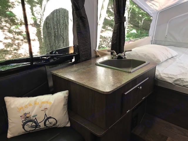 Sink area w fridge and radio with blue tooth underneath.. Forest River Rockwood 2018