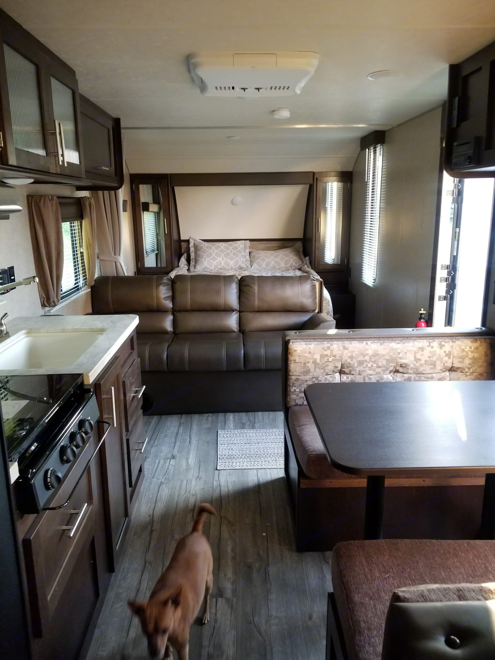 View of front half full bed and couch. Eating area.. grey wolf bunkhouse 2018