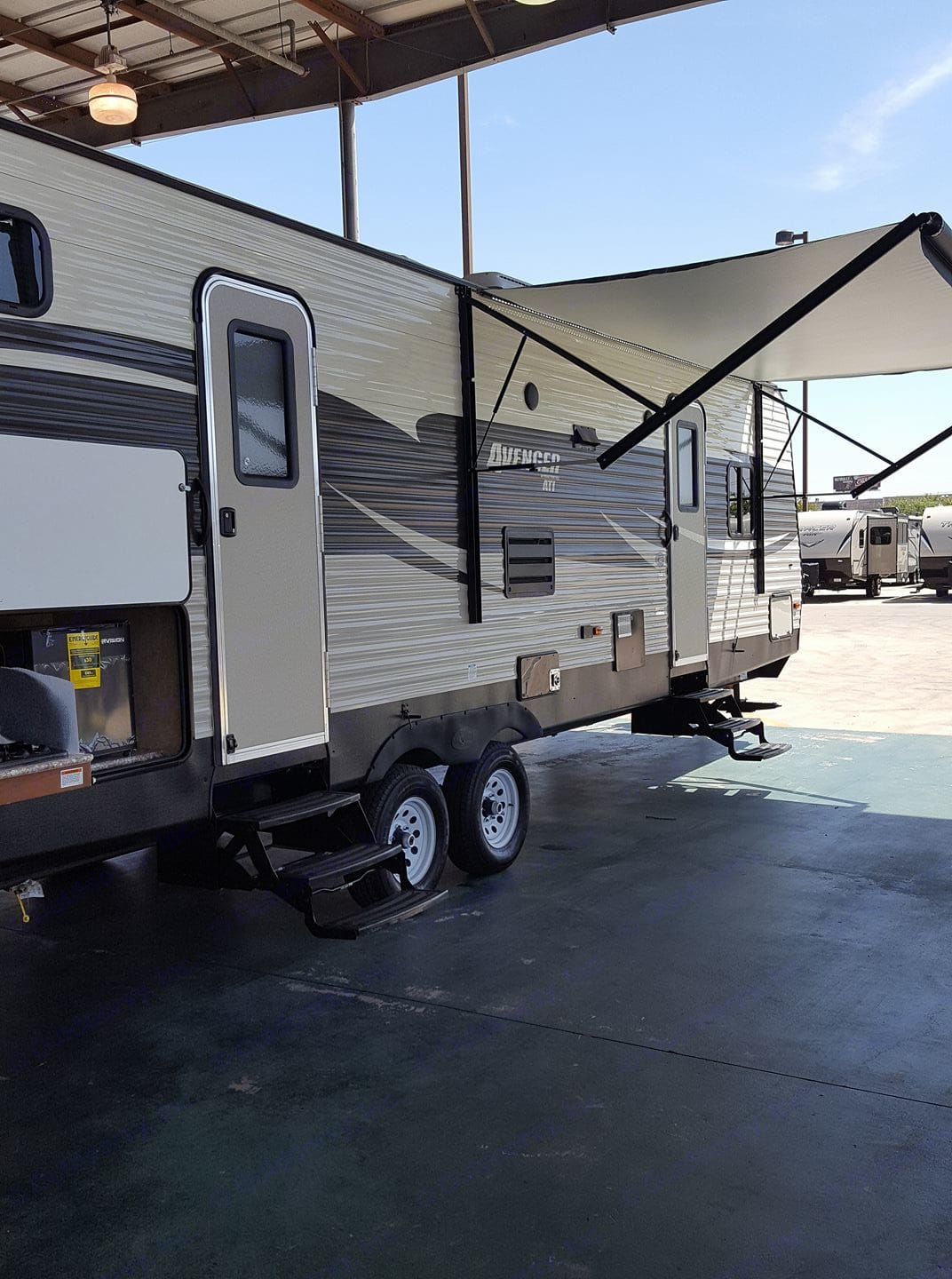 Fixing to pull it out of the dealer for the first time. Awning is awesome. Outside stove and shower. Prime Time Avenger 2017