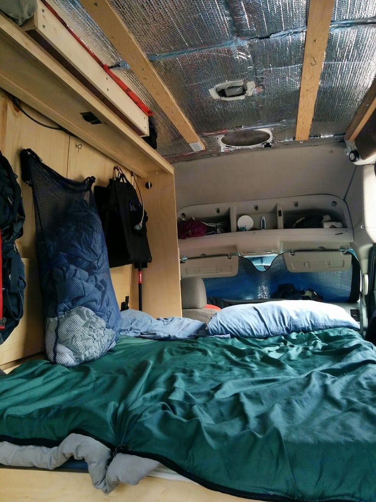 The murphy bed setup.  The desks fold up and the bed swings down.. Nissan NV2500 2012