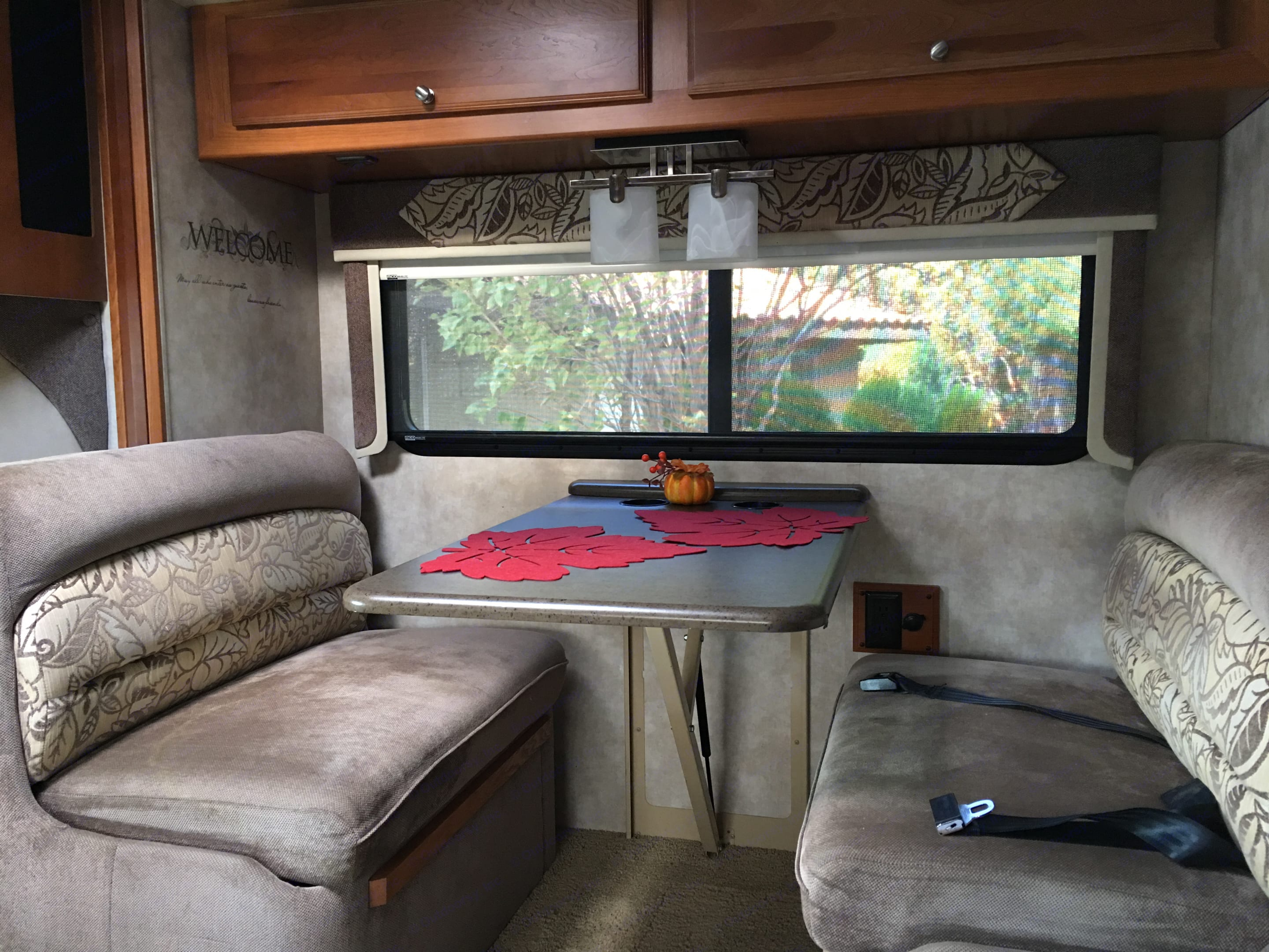 Nice Dining Room area.  Table folds down to accommodate a bed for a child.. Winnebago Aspect 2011
