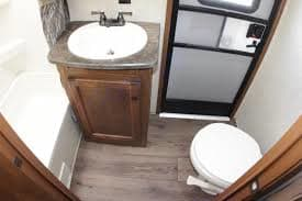Bathroom features an additional door for entry when you are outside. Keystone Sprinter 2014