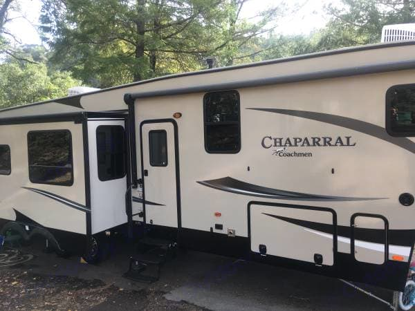 Awning and entrance side with kitchen slide out. You can access the under storage from both sides of the 5th wheel.. Coachmen Chaparral 2017