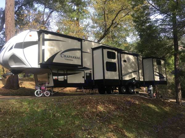 4 of the 5 slides are on this side of the camper and in this picture are all out which opens up the front bedroom, kitchen opposing slide, bunk room and back bedroom which is also where the second bathroom is located.. Coachmen Chaparral 2017