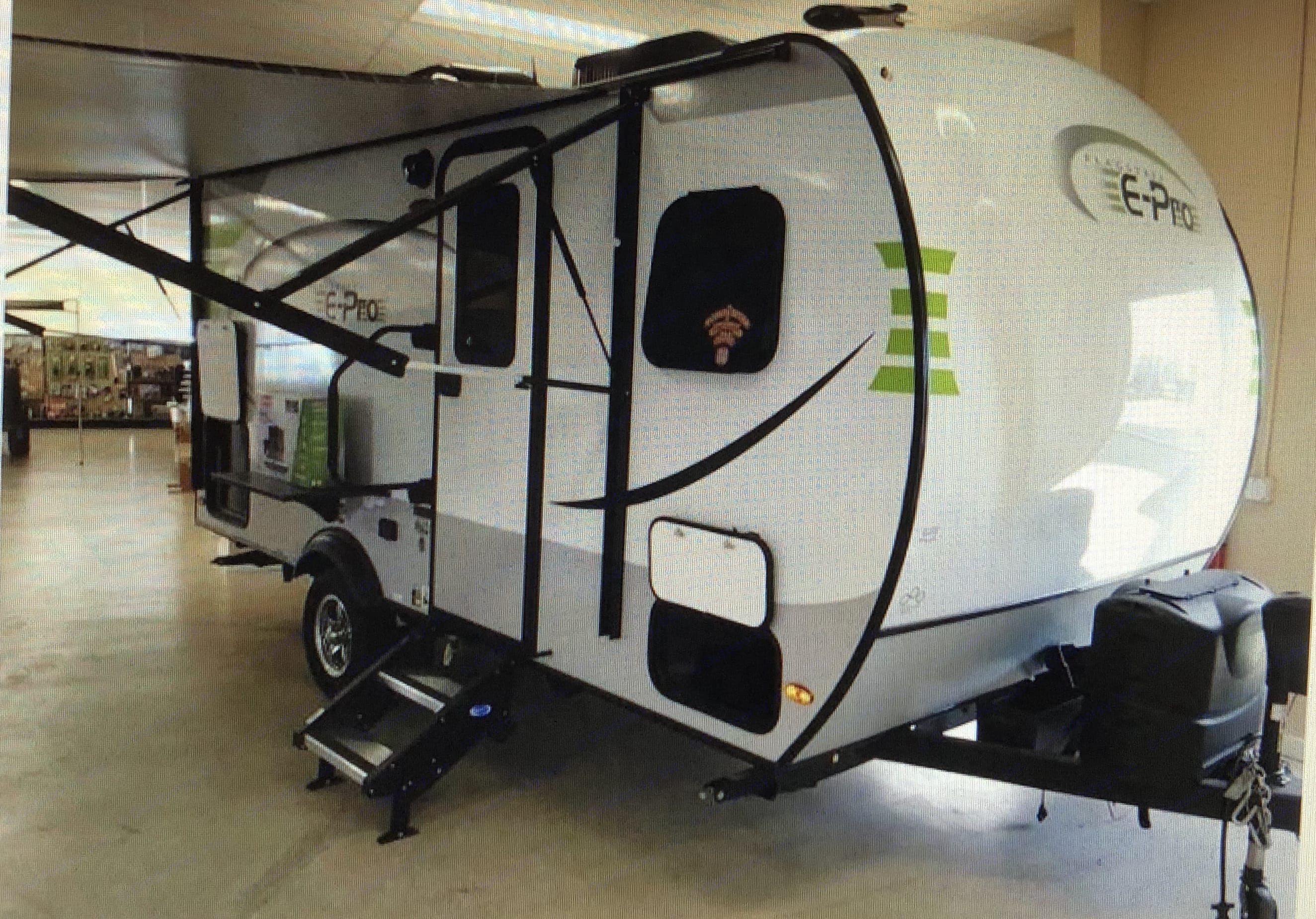 This awesome camper has an outdoor refrigerator and access to storage. There is a slide on table that holds a table top grill or a TV! We also had a bike rack installed!. Forest River Flagstaff E-pro E16 2018