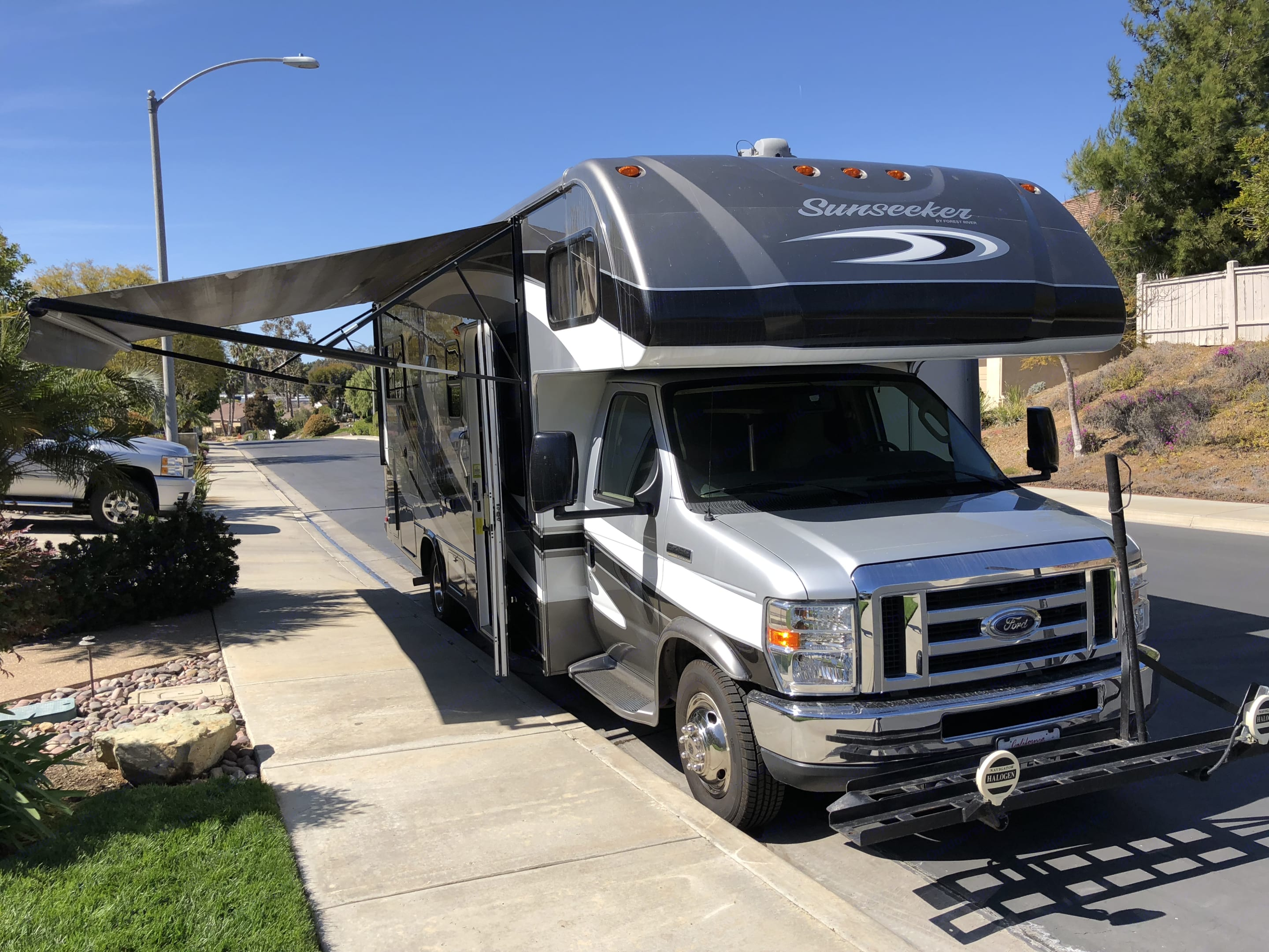 Front View - motorcycle carrier and awning extended.. Forest River Sunseeker 2014