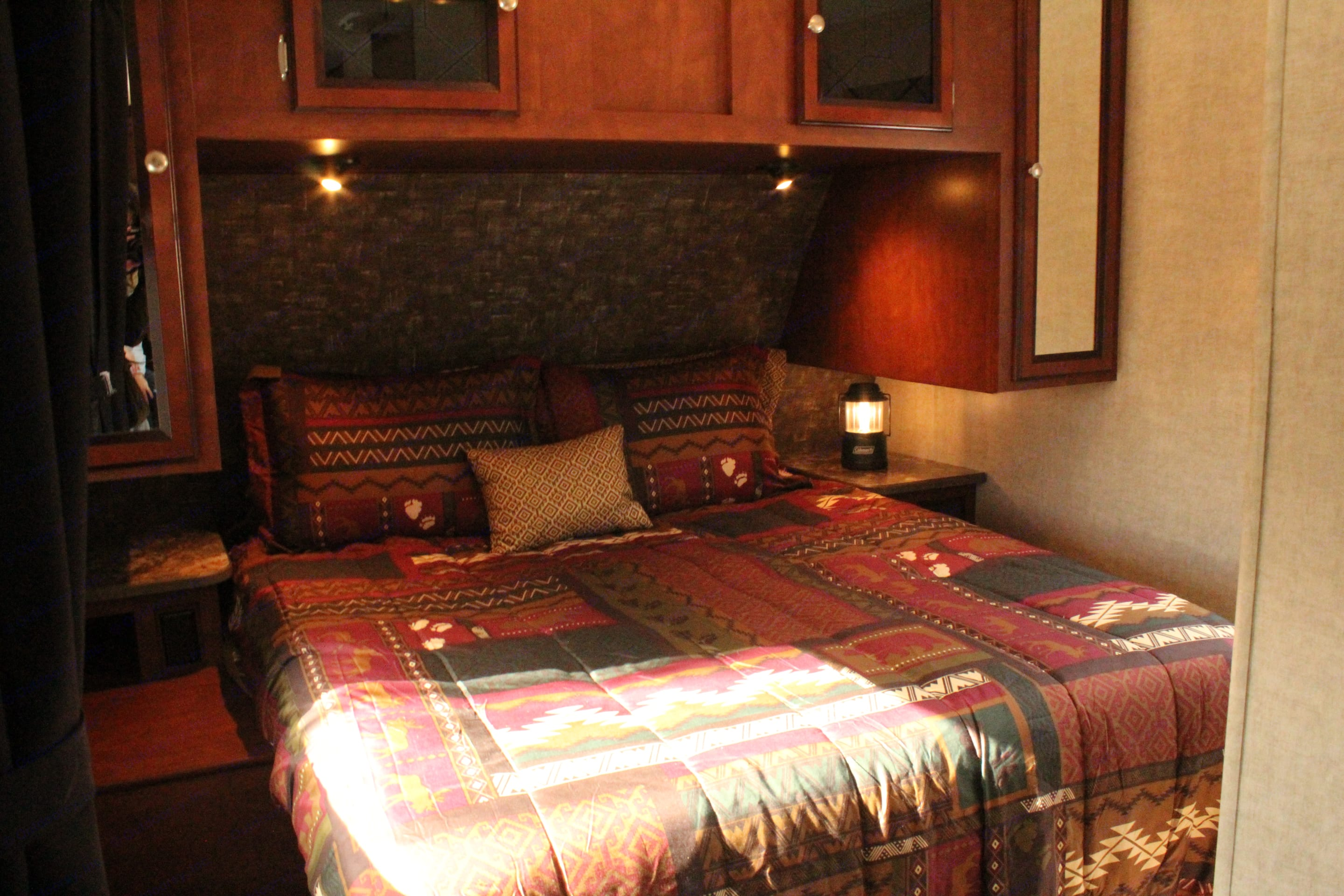 """Master Bedroom with (RV) Queen-sized bed (60"""" x 75""""). Heartland Wilderness 2015"""