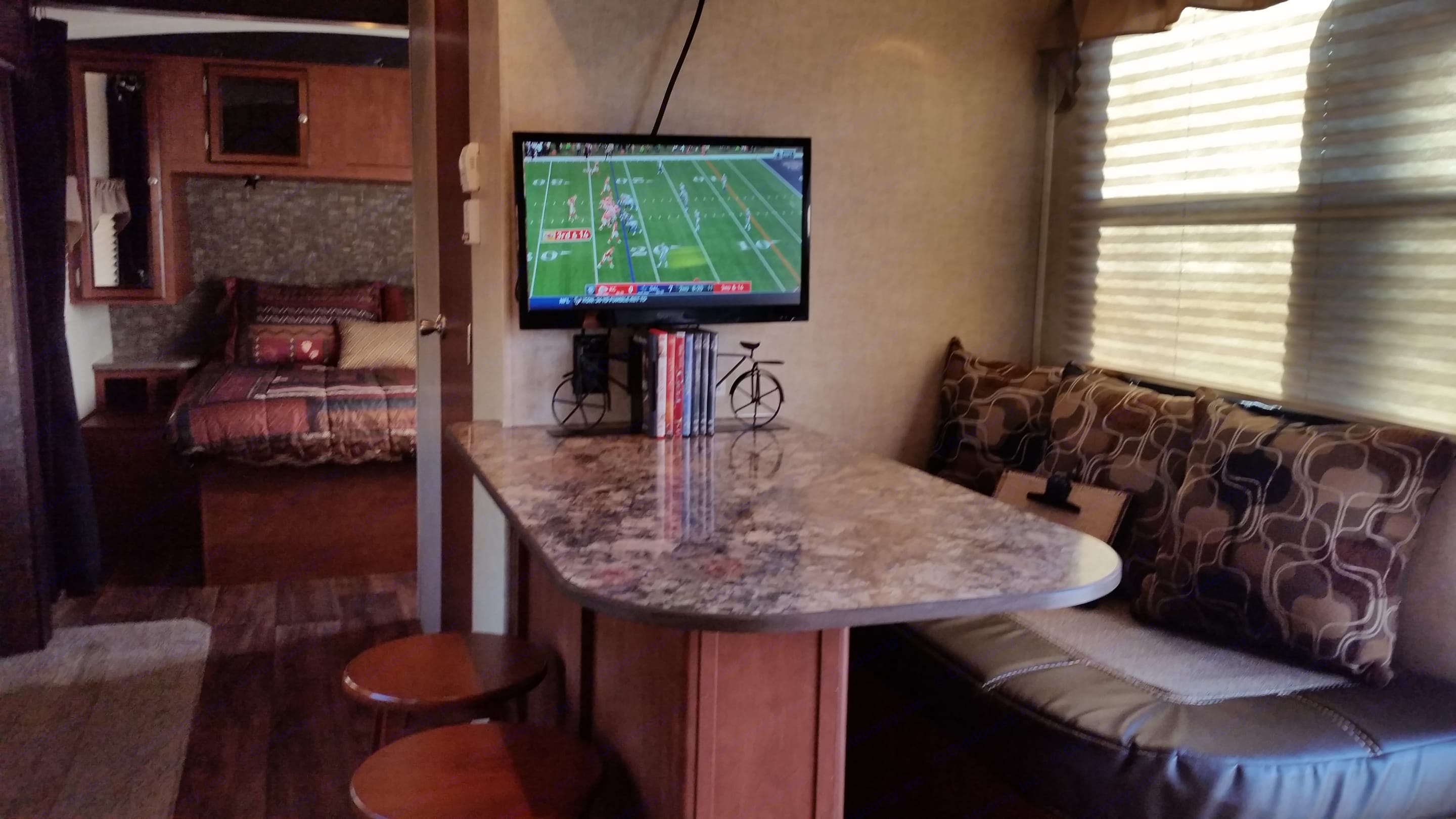 Just because you are camping doesn't mean you have to miss the big game.  The trailer comes equipped with an omni-directional antenna that can pick up HD over-the-air TV signals.  We also have hook-ups for cable and/or satellite . Heartland Wilderness 2015