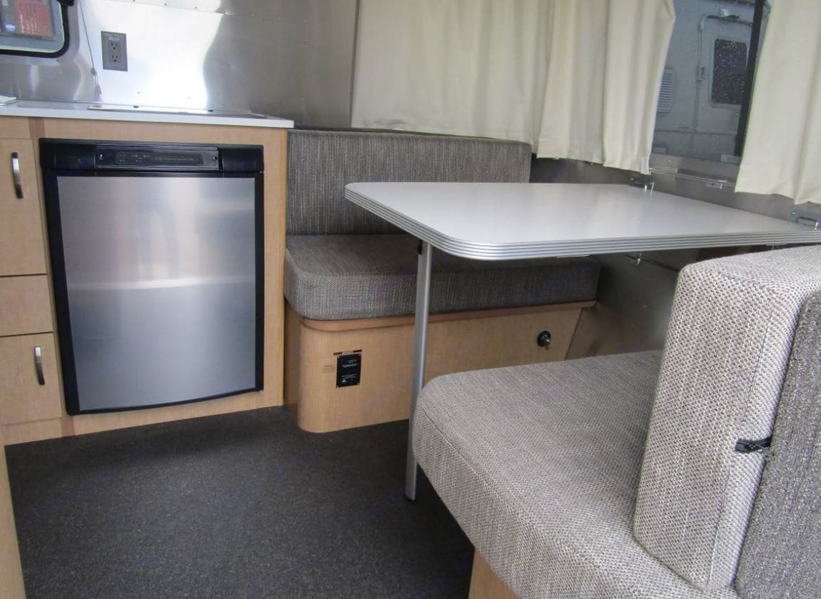 Refrigerator, 2 burner stove top, Dining table converts to bed. Airstream Sport Bambi 2015