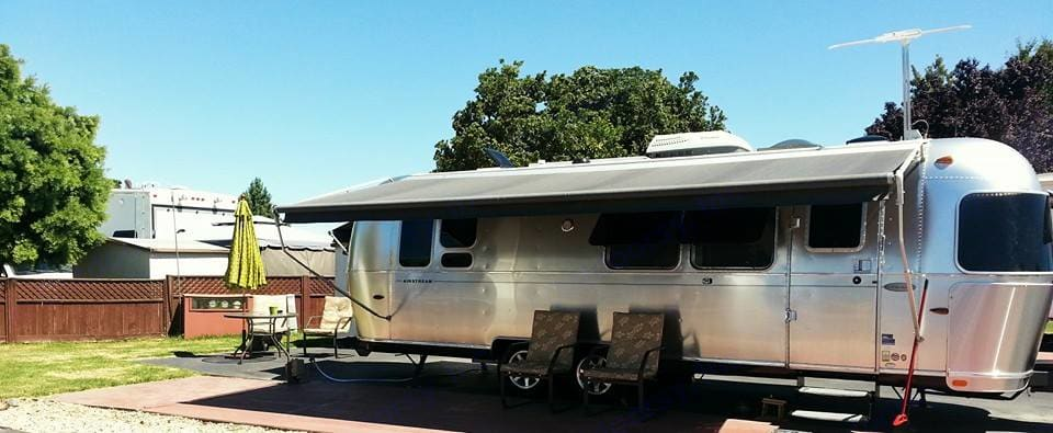 Parked at an RV park w/Awning (Patio furniture not included). Airstream Flying Cloud 2012