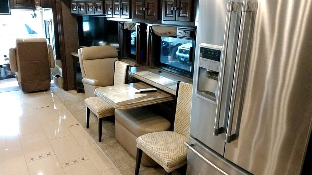 Residential Fridge, table, lounger, TV and Fireplace. Tiffin Allegro Bus 2015