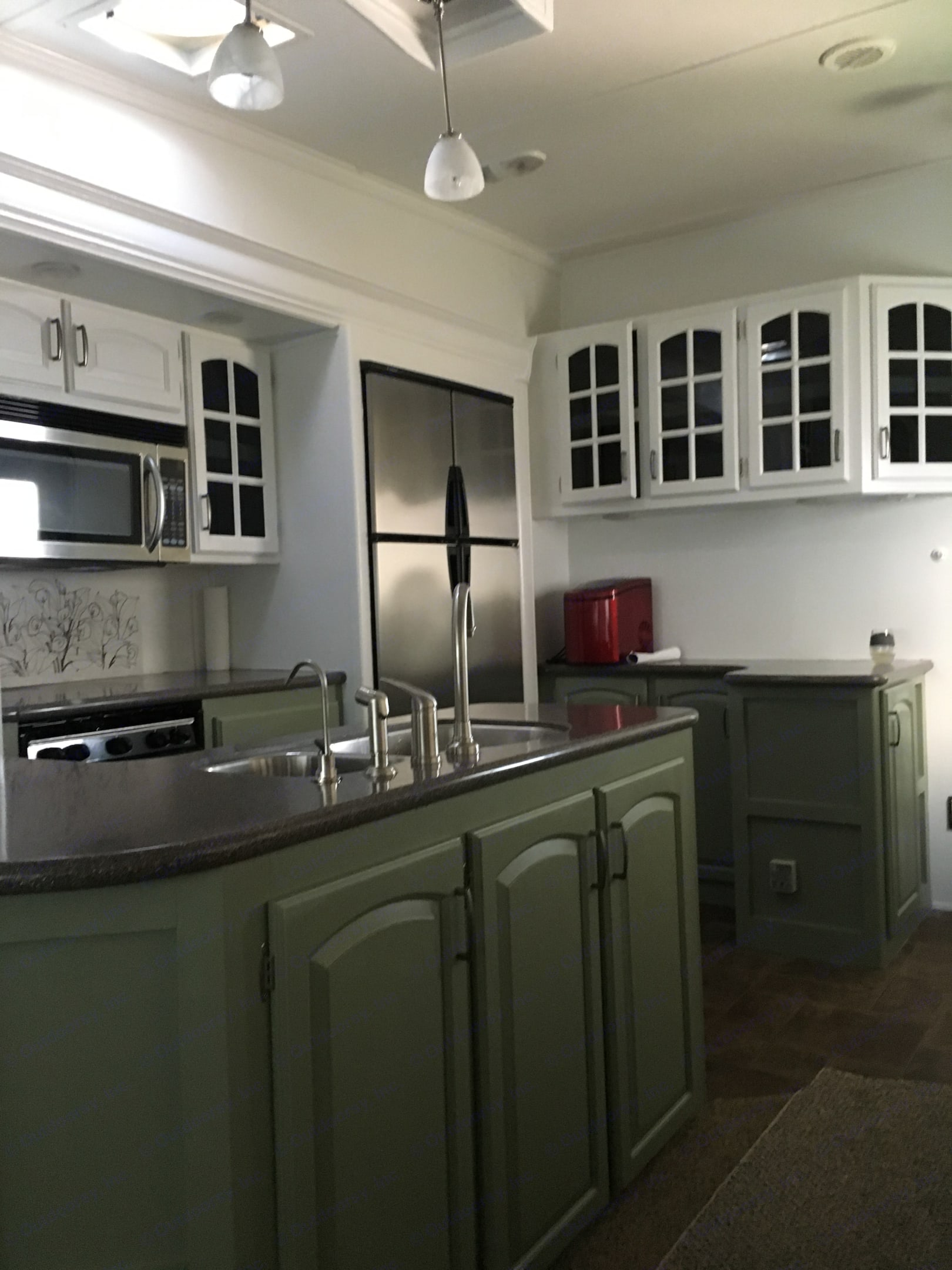 Kitchen with 4 door refrigerator, microwave/convection oven. Stove top/oven. Keystone Alpine 2010