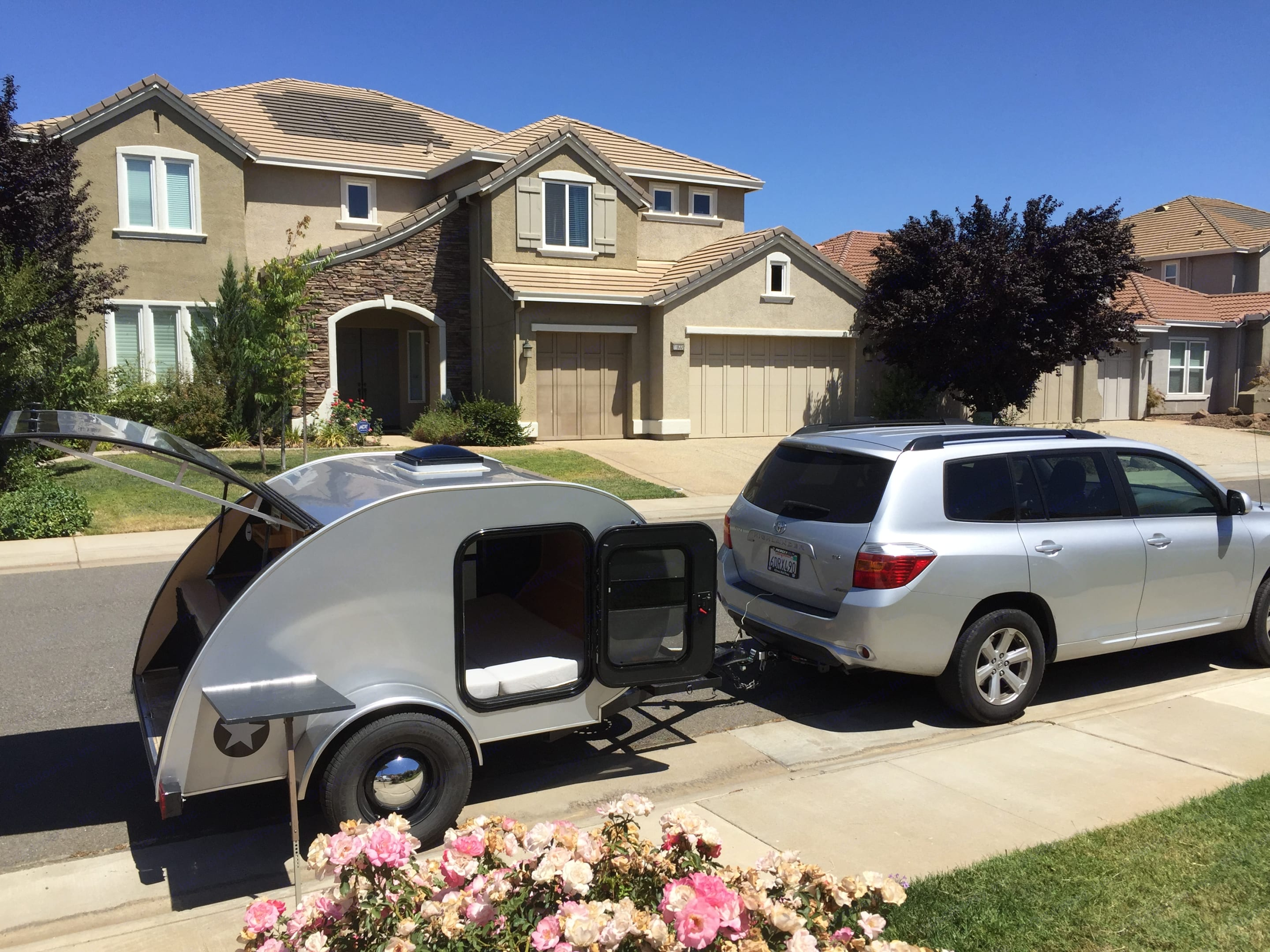 Teardrop trailer in front of my house hitched to my Highlander to show size.. American Teardrop Travel Trailer 2009