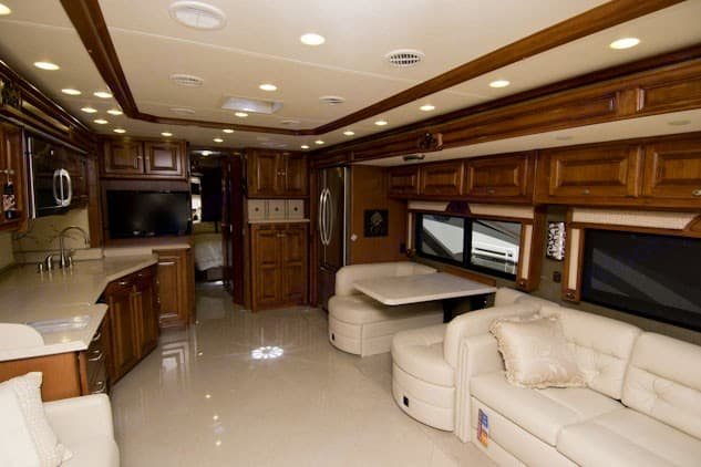 A large living room and kitchen. Tiffin Motorhomes Phaeton 2013