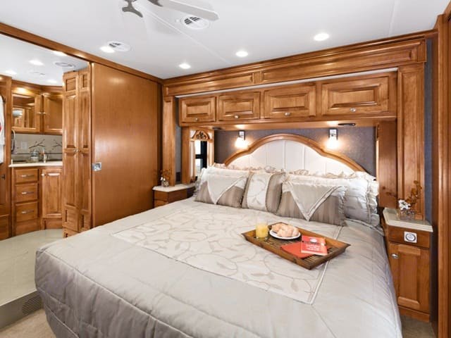 Relax in this private, luxurious bedroom. Tiffin Motorhomes Phaeton 2013