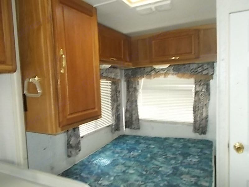And the dinette converts to a bed.  And the loft (area above the cab) is huge. . Thor Motor Coach Four Winds Majestic 2000