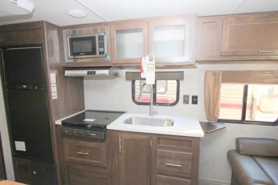 Great kitchen with microwave, stove, freezer, and fridge.. Forest River Cherokee Grey Wolf 2018