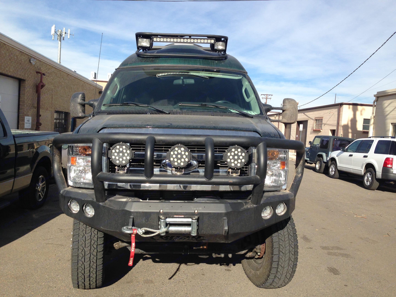Front; bumper, flood lights, spot lights, winch. Ford E350 Custom Off-road Conversion 2010
