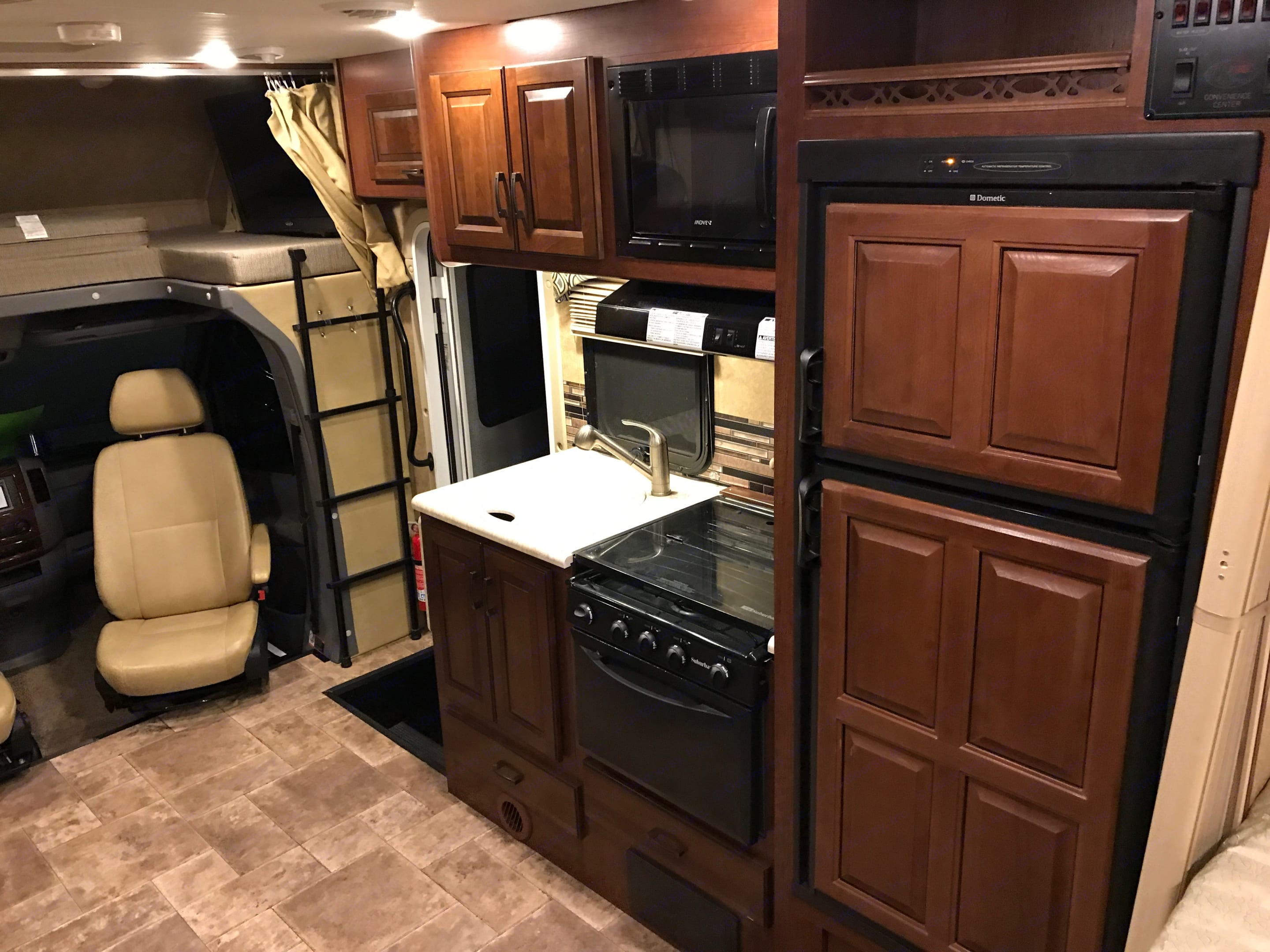 Kitchen with Microwave, Stove and Refrigerator. Forest River Solera 24S 2015