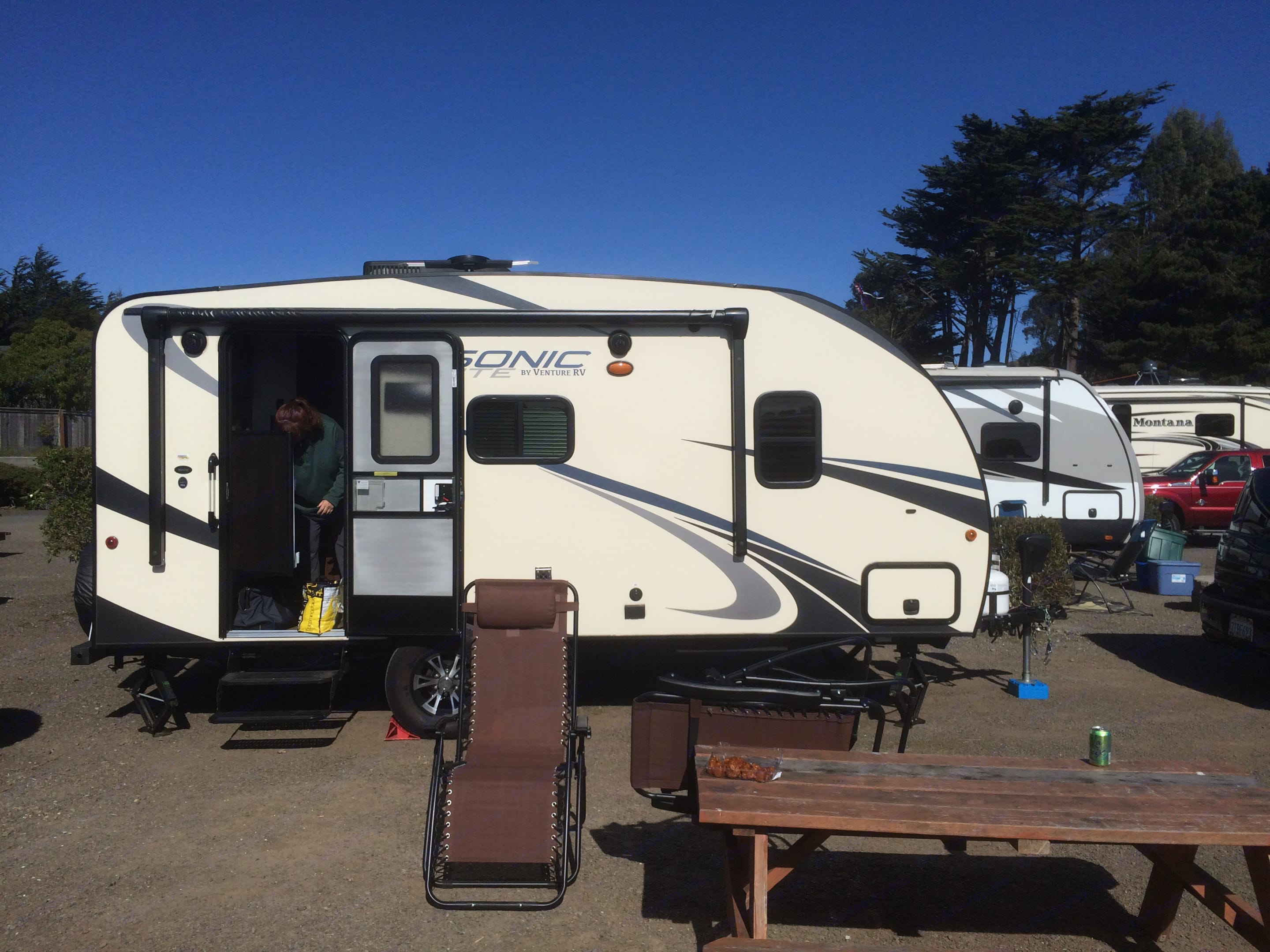 Exterior entry side, with awning and outside speakers.. Venture RV Sonic Lite 2017