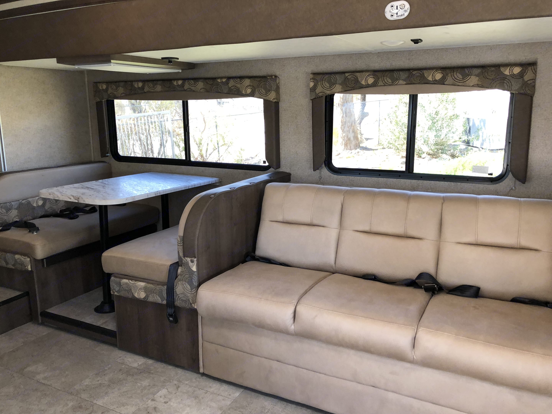 Roomy galley seating. Coachmen Freelander 28BHS 2019