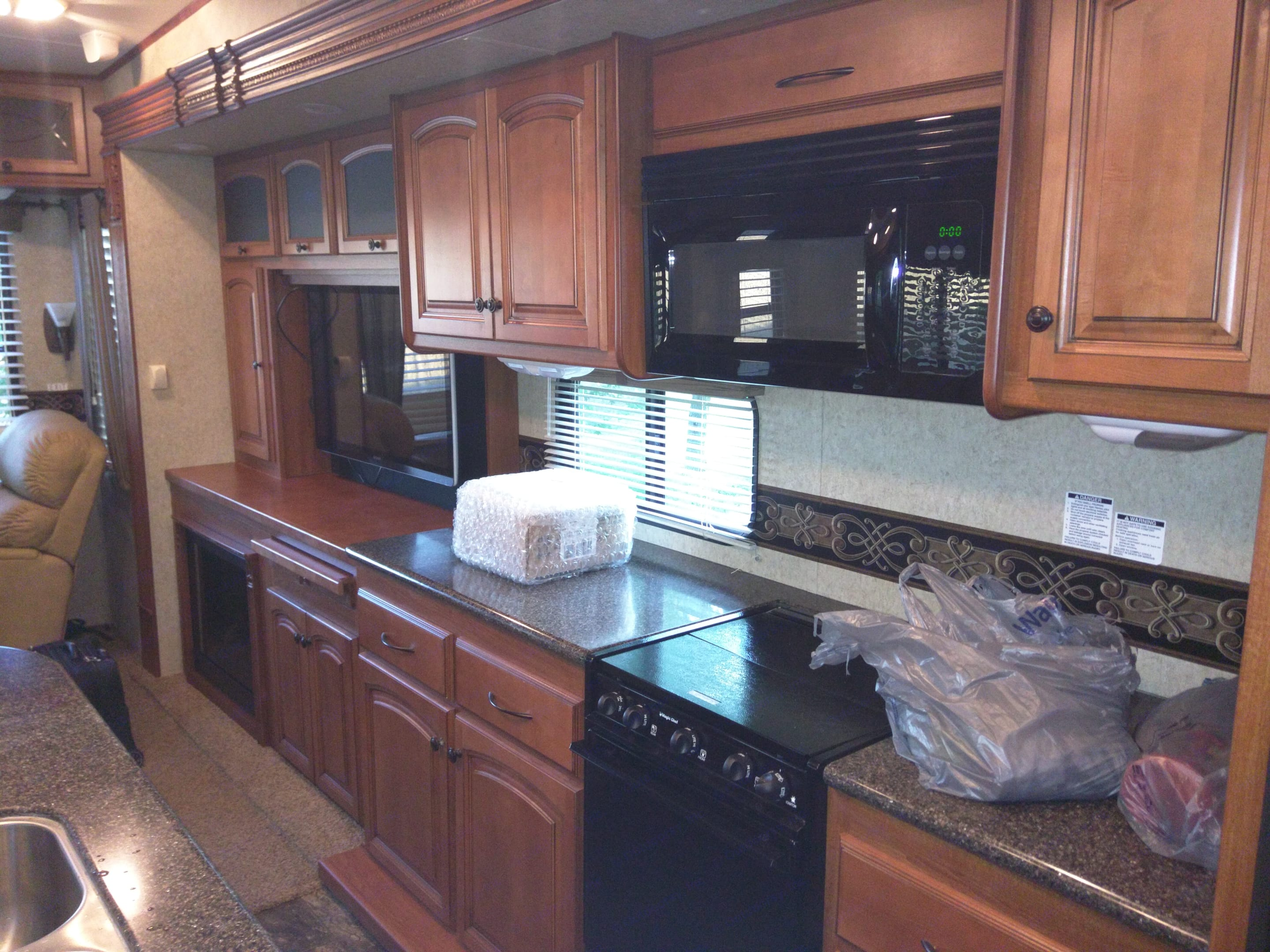 As much counter top and as nice acabinets as many homes.. Heartland Big Country 2011
