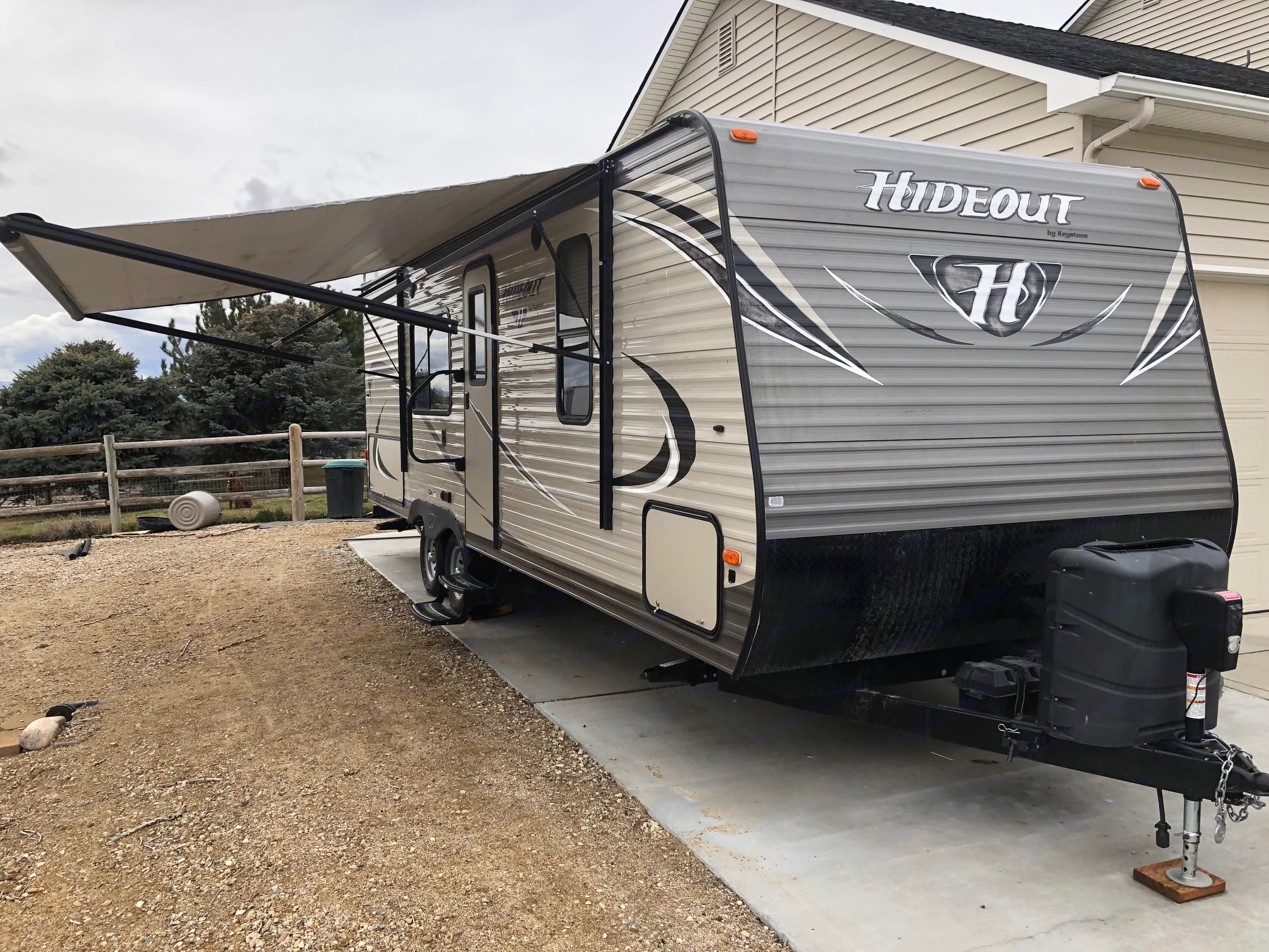 Exterior view with the awning extended.. Keystone Hideout 2016