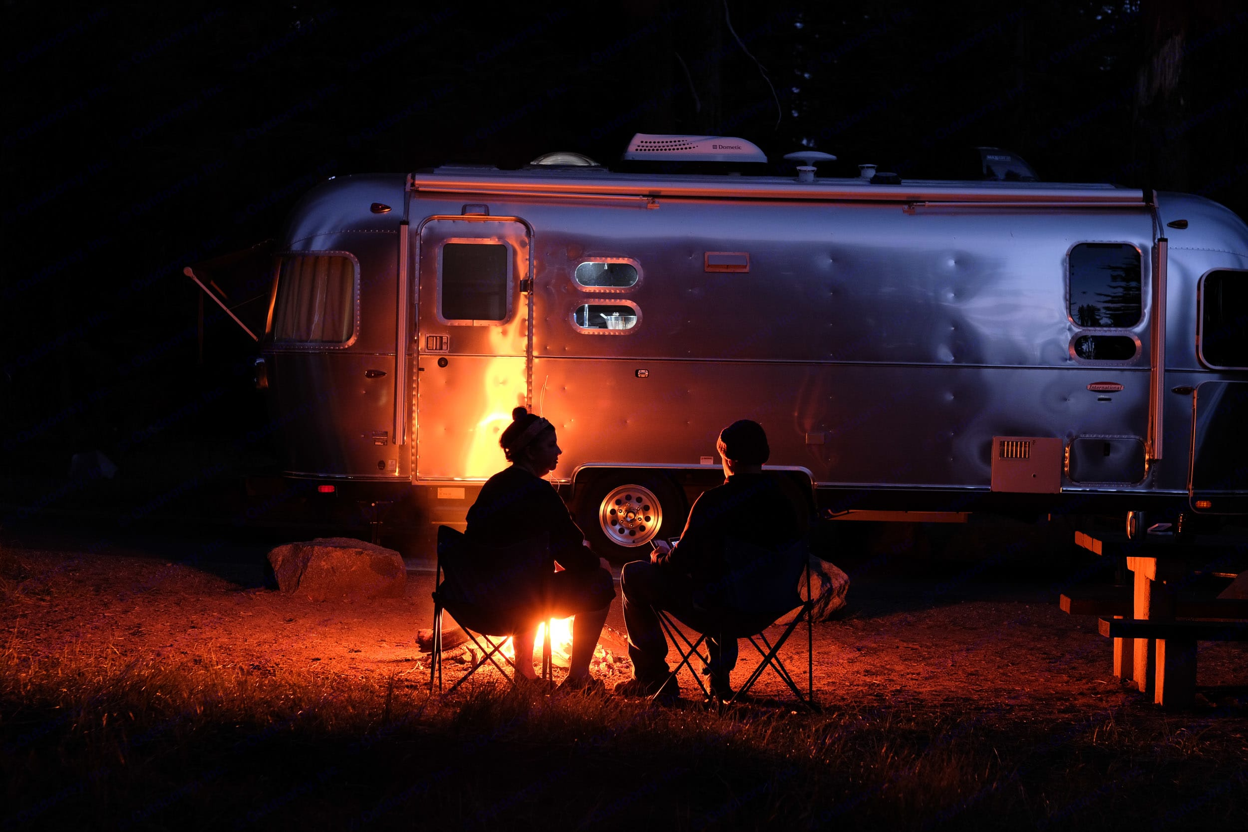 Enjoy a campfire with all of the amenities of home just a few feet away. . Airstream International 2016
