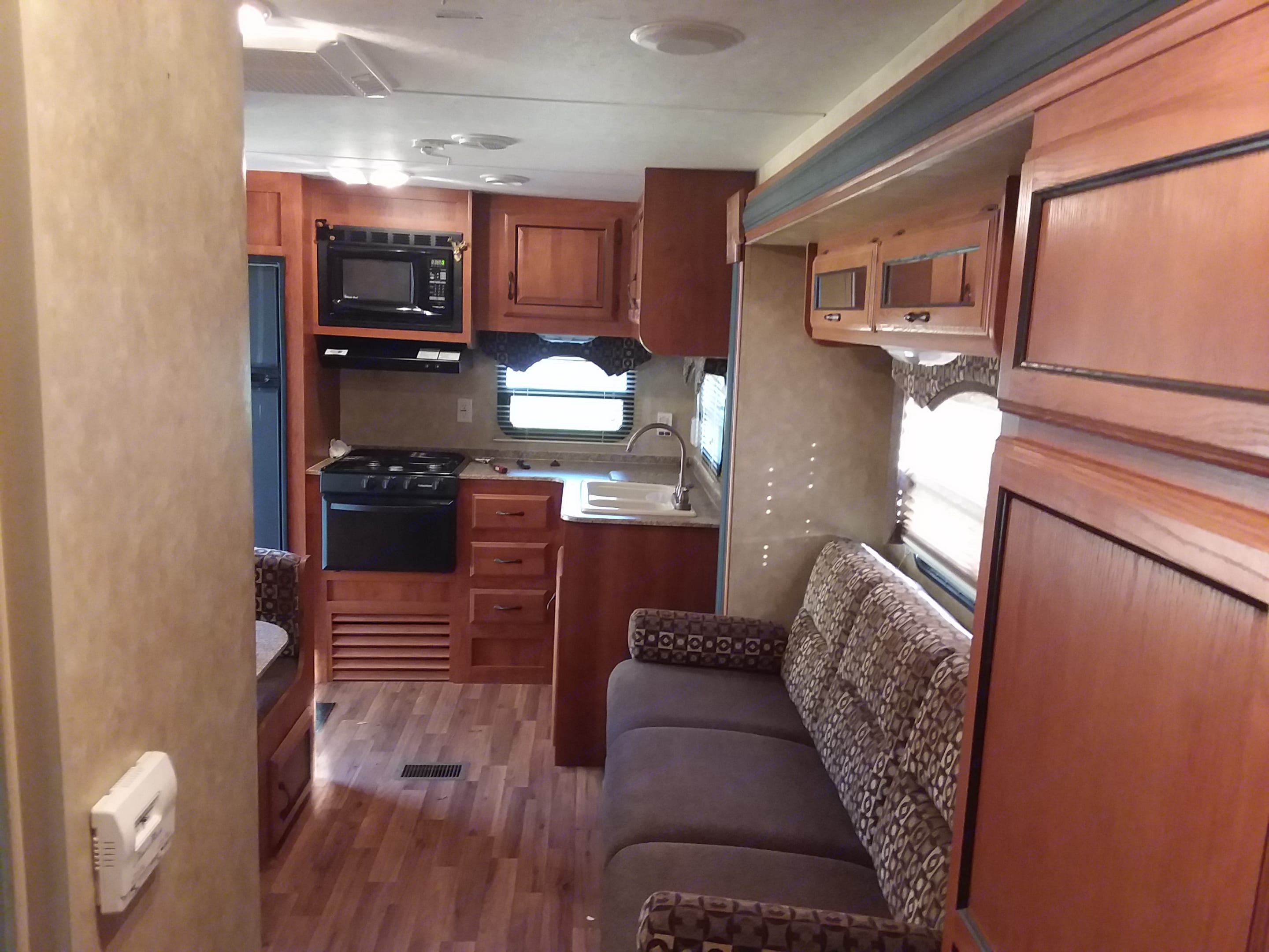 Couch pulls out to a bed and table turns into a bed. Coachmen Catalina 2012