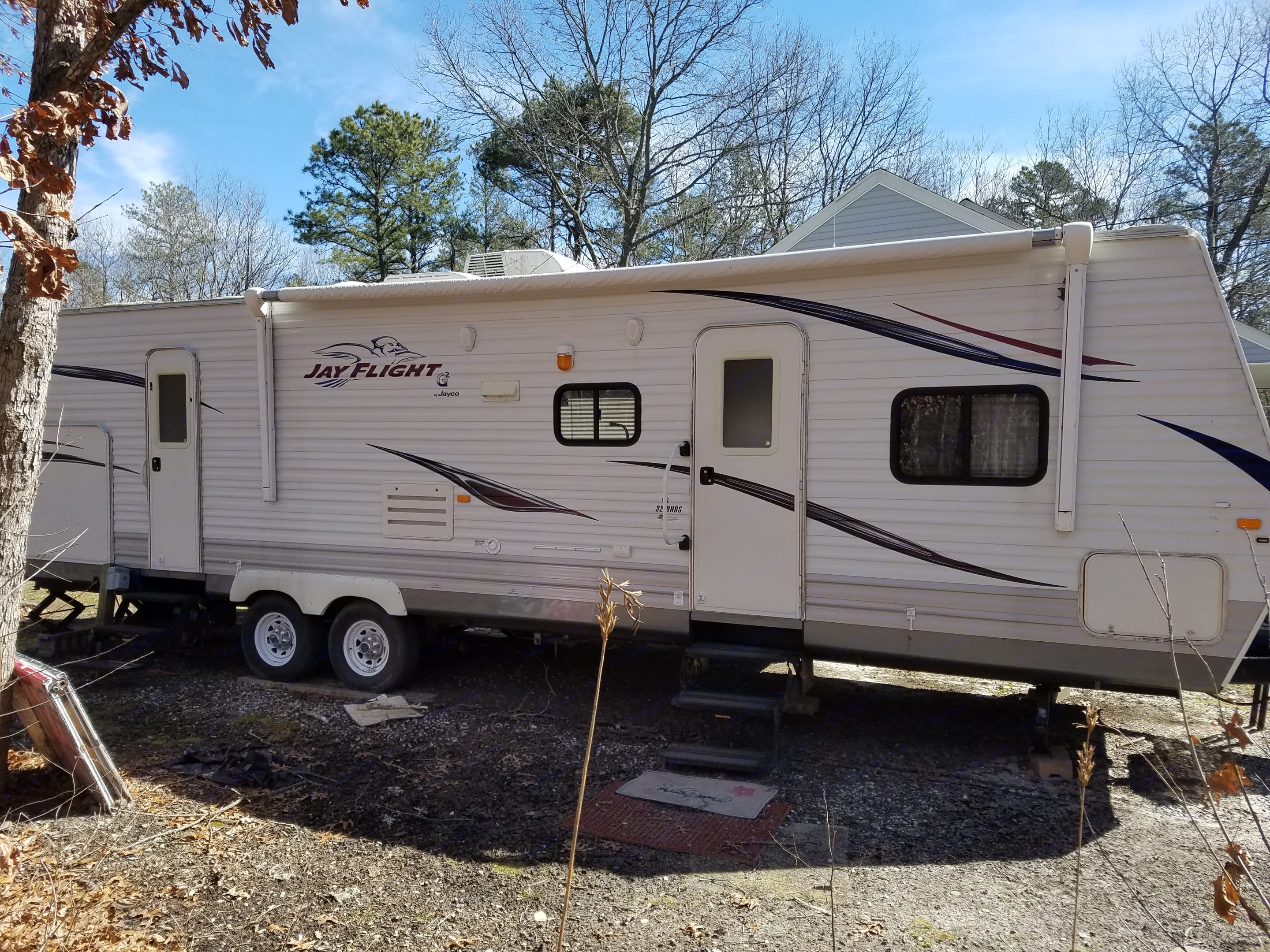 Other side and enterances with electric awning . Jayco g2 bunk house 2010