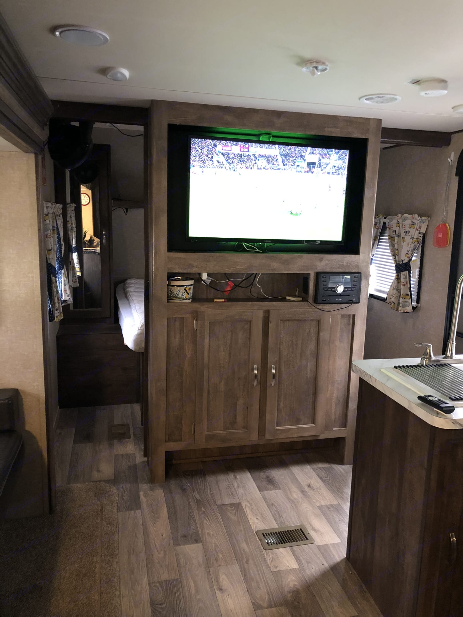 """40"""" TV w/Antena rotates between Master and living area.  . Forest River Vibe 2017"""