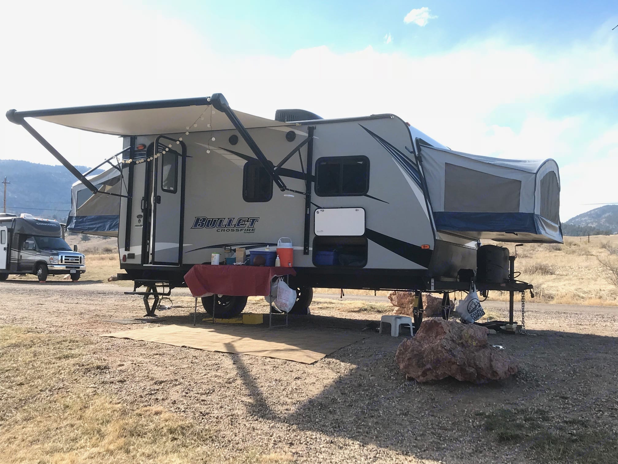 Outdoor lighting, camp chairs, table, and outdoor grill are all included. . Keystone Bullet Crossfire 2018