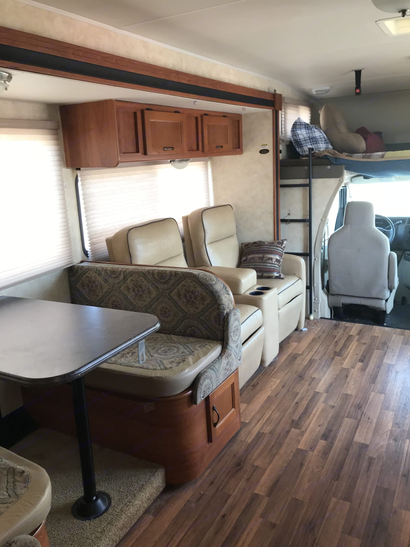 Dining and recliners. Enjoy comfort while watching tv or relaxing to your favorite music. Coachmen Freelander 2012