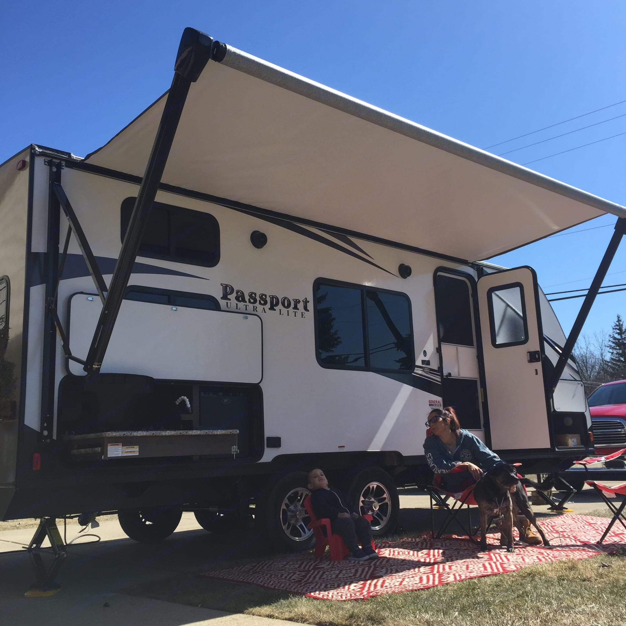 Extend the awning with the push of a button, sit back and relax!  Outdoor rugs, chairs and hammocks are available to enhance your camping experience.. Keystone Passport 2018