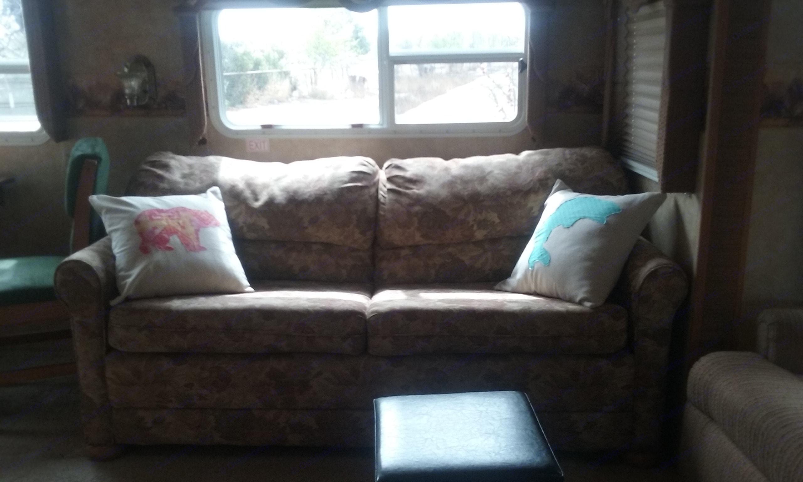 The living room sofa makes into a bed, too.. Jayco Eagle 2007