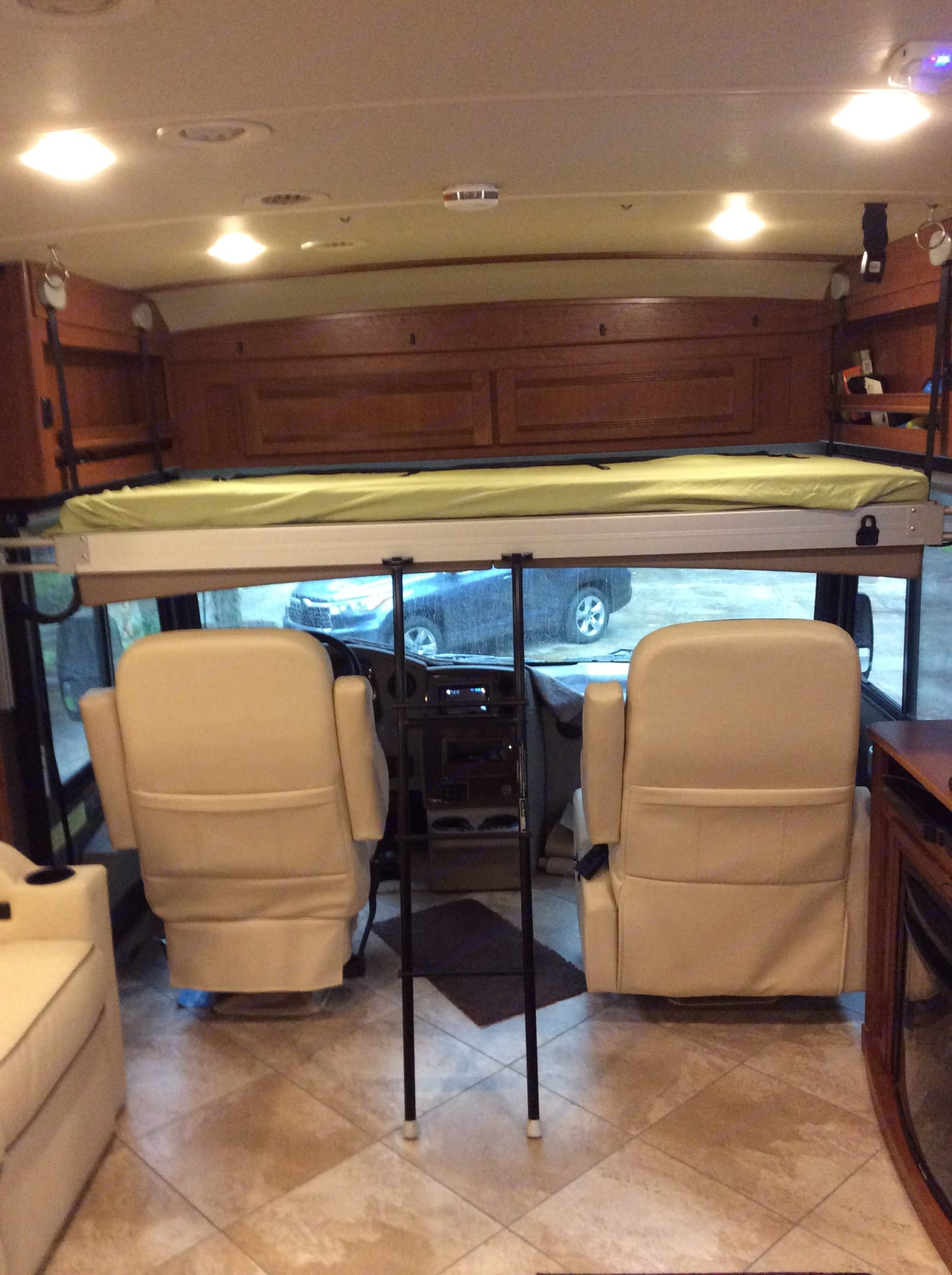 Drop down sleeping bunk.  This is located above the drivers cock pit and takes only seconds to set up!  Holds up to 275lbs. Winnebago Forza 2017