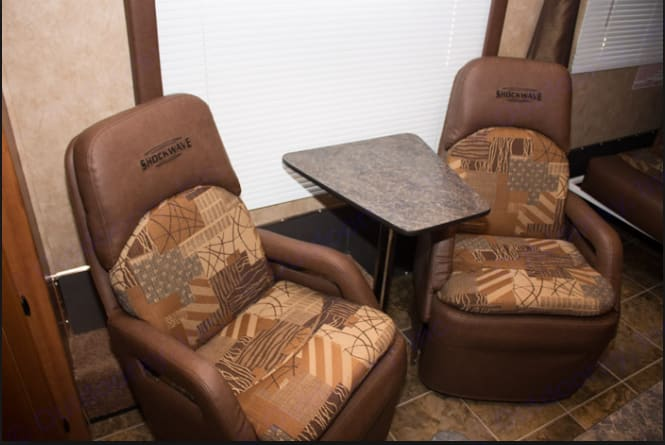 I pulled this picture from the Shockwave website.  Shows the Captain's chairs.  Upholstery is a little different.  Same color Scheme.. Forest River Shockwave 2012