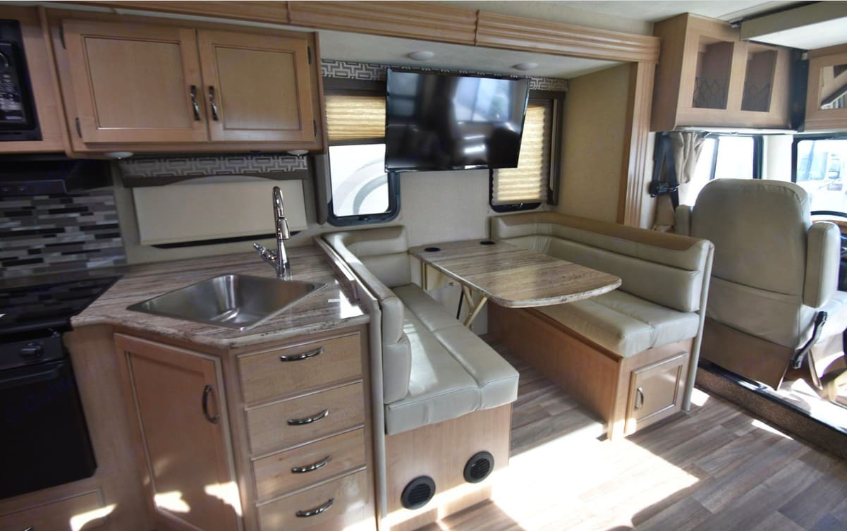 """40"""" LED TV, Blue-Ray Player, Cable TV ready, Digital TV antenna, and Central ducted A/C (2 A/C units in Coach) in the living area, Kitchen and dinette are close by for easy serving and conversation while cooking.. Thor Motor Coach A.C.E 2018"""