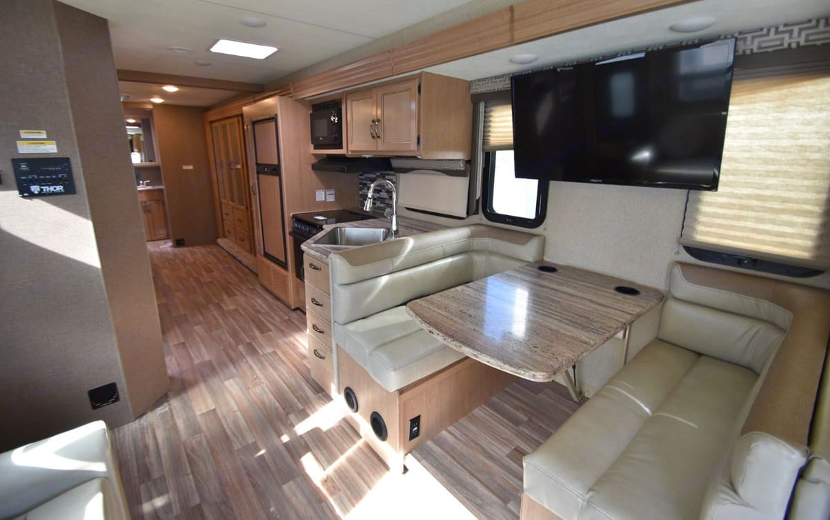 This gorgeous 2018 Thor A.C.E. 32.1 is the only one with 2 FULL Baths and it has Vast Indoor Space with a Super Slide that opens up one whole side of the coach, plus a second Slide on the opposite side in the bedroom. This coach feels HUGE inside and is exquisitely decorated as well. . Thor Motor Coach A.C.E 2018