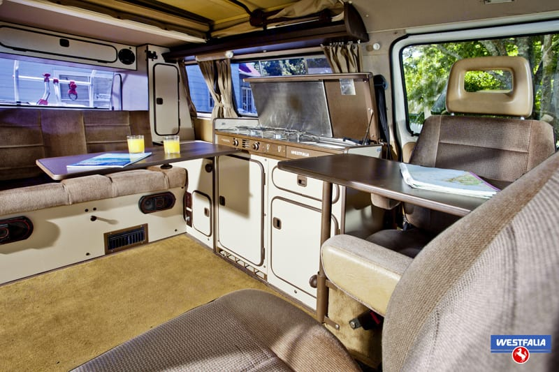 Swivel the Captain Seats to have more space and enjoy everyone's company. This is an interior to our brown van (all vans similar).. Volkswagen Vanagon 1987