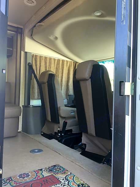 seats swivel to add to make for comfy evening relaxation. Table may be placed in front of chairs or loveseat.. Winnebago Via 2010