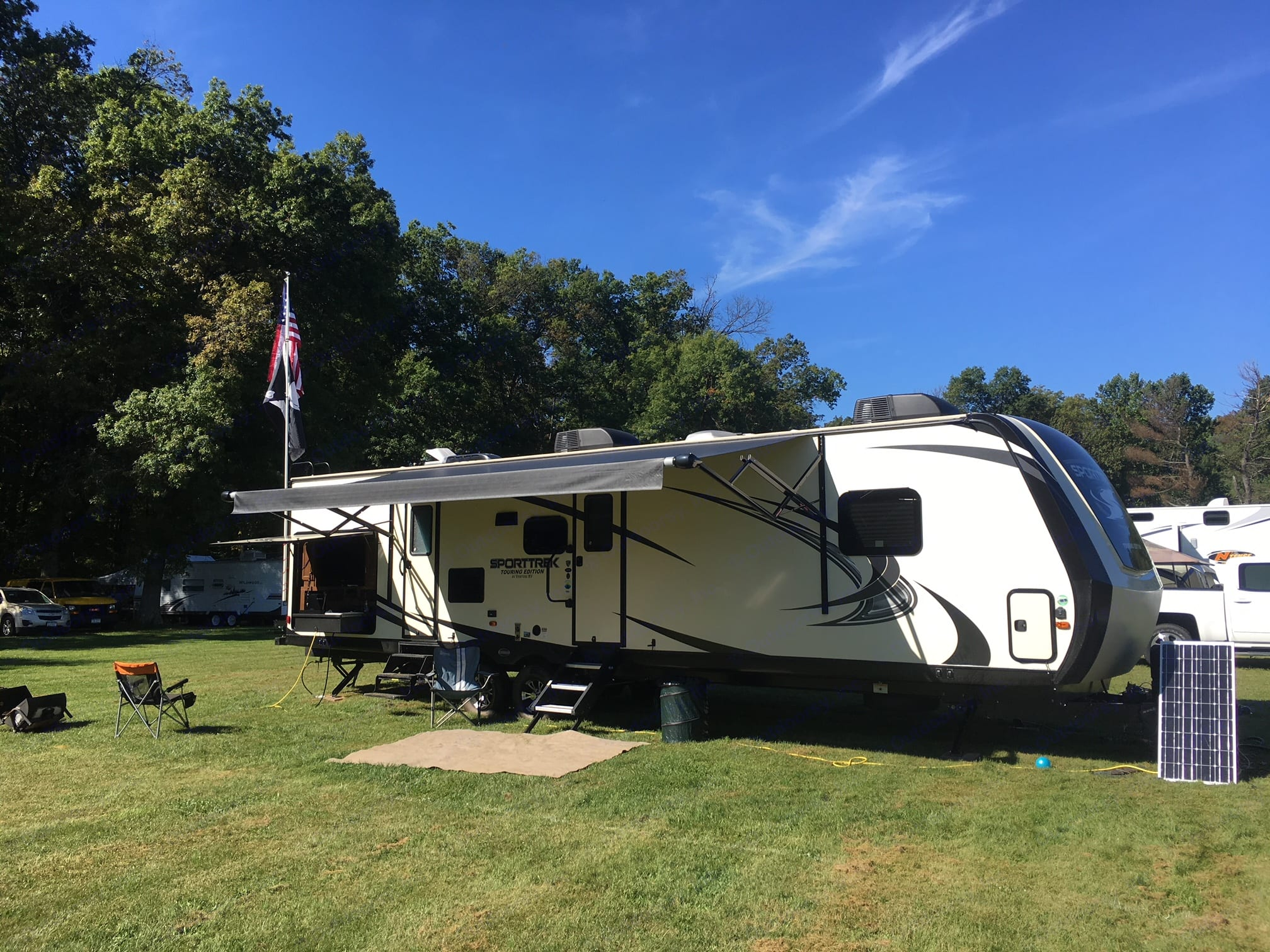 exterior with the awning and kitchen/TV opened up. Venture Rv Sporttrek 2018